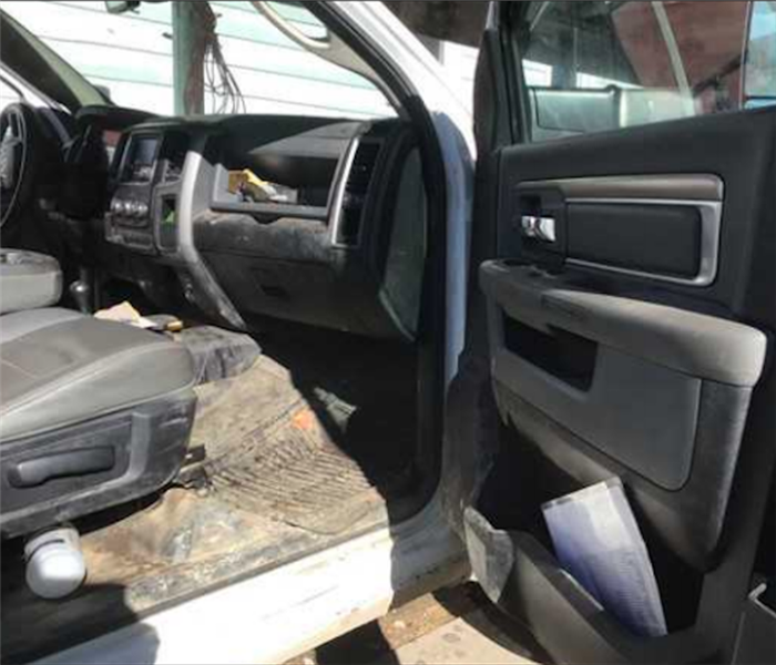 Black Interior of Truck with dirt