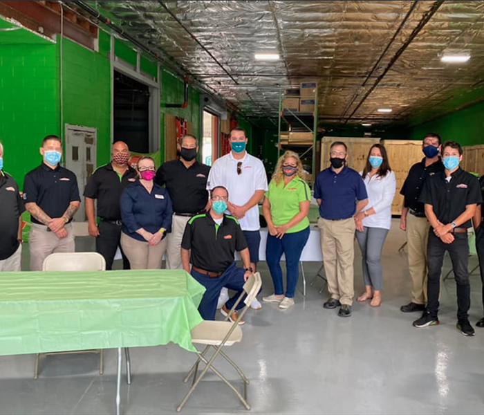 Servpro employee group photo in Servpro warehouse