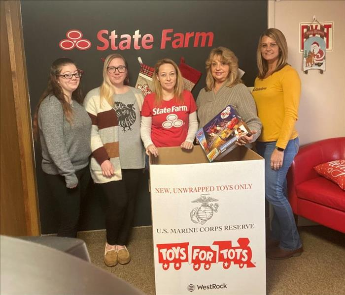 State Farm reps with Toys for Tots box and Toy