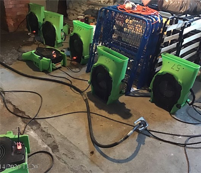 SERVPRO green fans set up in concrete basement