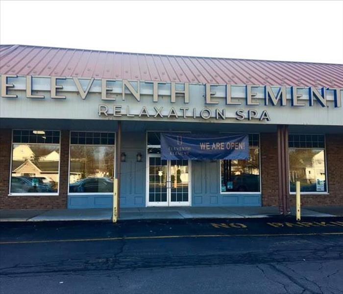 "Store front with ""Eleventh Element"" sign"