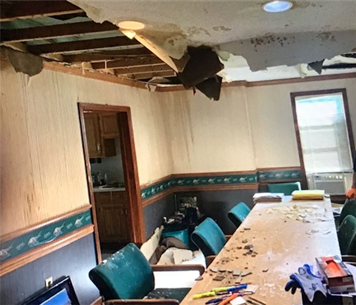 Water Damage to conference room of office, missing ceiling