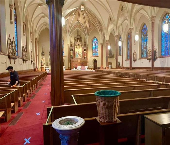 SERVPRO techs cleaning pews of a church