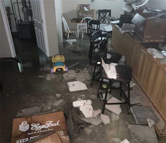 Ceiling tiles and debris on floor from water damage