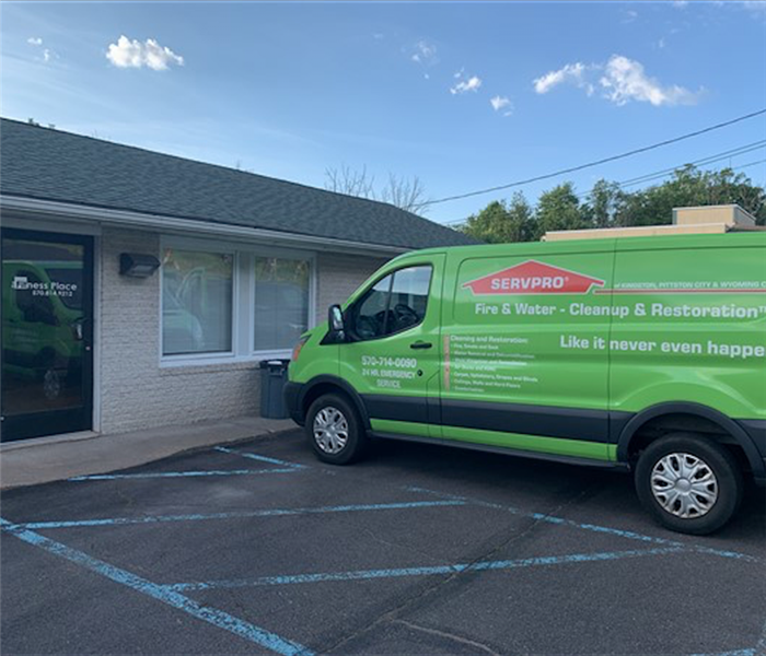 SERVPRO green van in front of commercial building