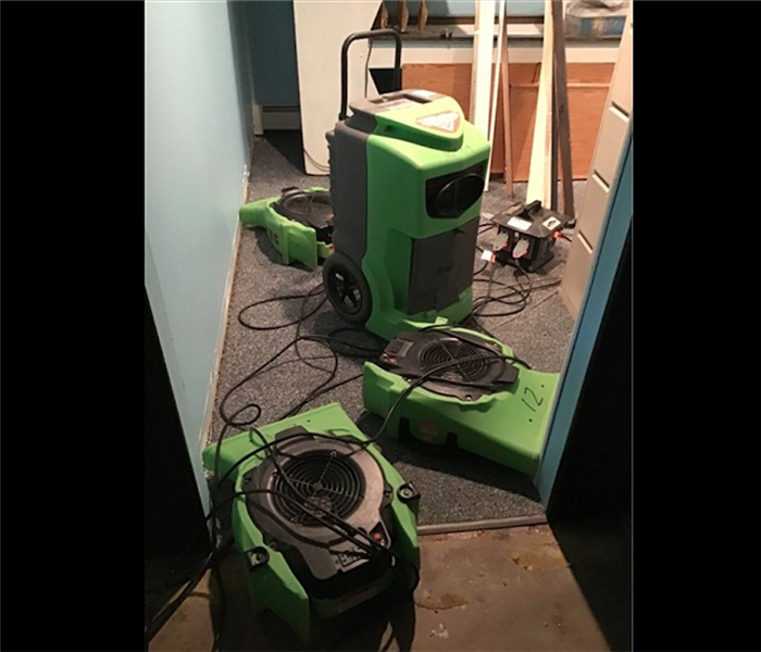 SERVPRO green dehumidifiers and air movers in residential home