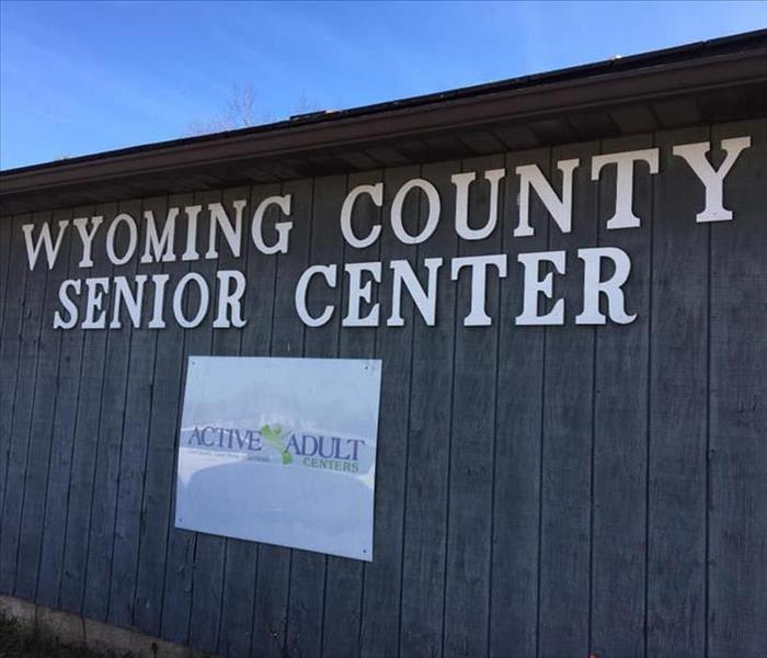 "Brown building with ""Wyoming County Senior Center"" text on it"