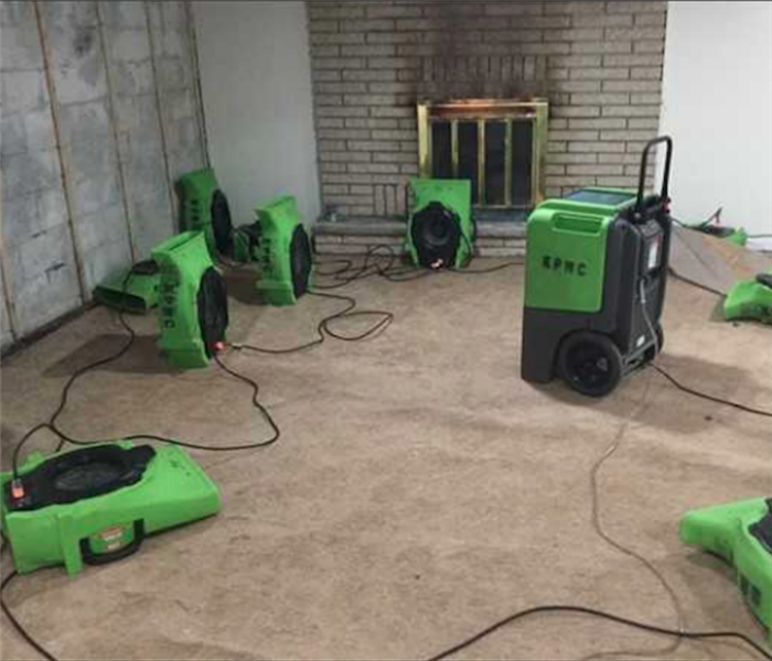 Green Servpro equipment in residential home