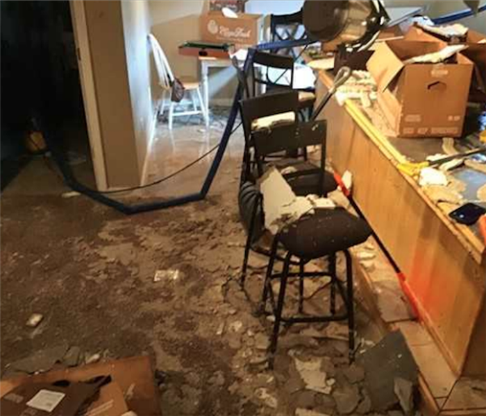 Water and debris on floor following water damage