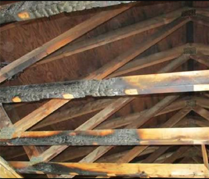 Burnt wood ceiling beams from residential fire