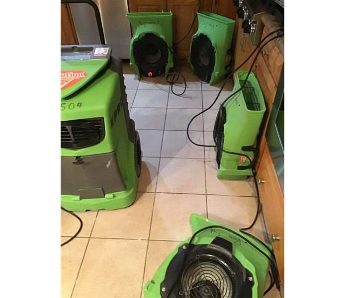 green SERVPRO equipment in kitchen of residential home