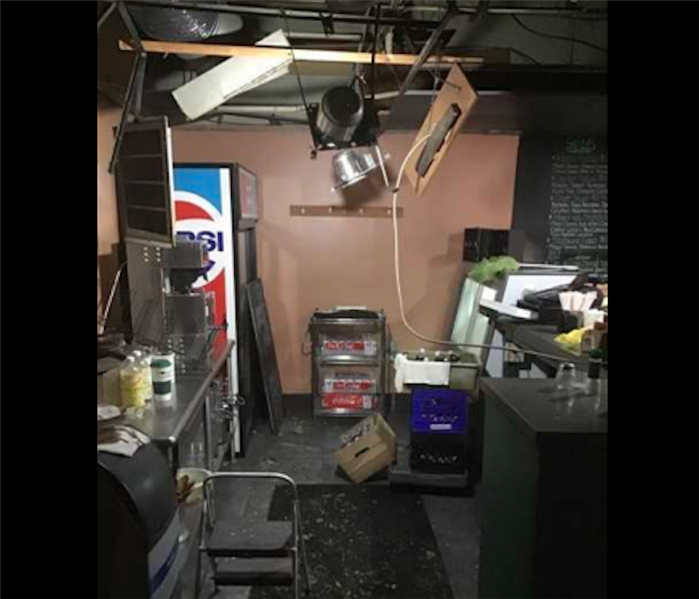 restaurant bar with water damage to ceiling