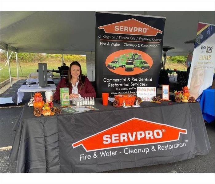 SERVPRO Rep behind SERVPRO table set up for Job Fair