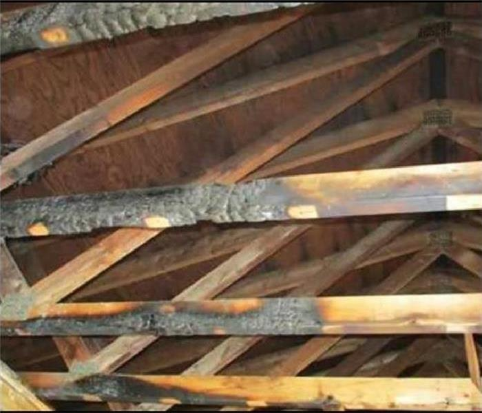 Fire Damage on Attic Wooden Beams