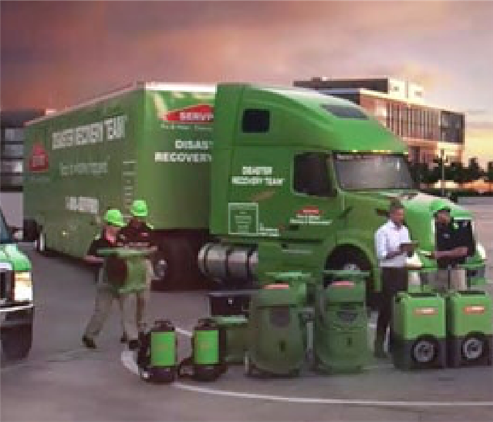 SERVPRO green commercial truck with employees in front of it