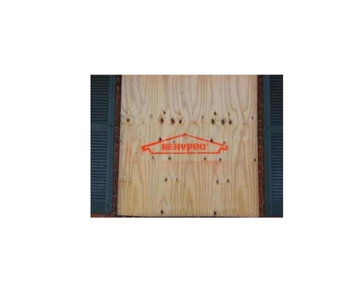 SERVPRO logo on wooden board used for board up