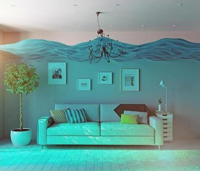 white couch in living room under blue water